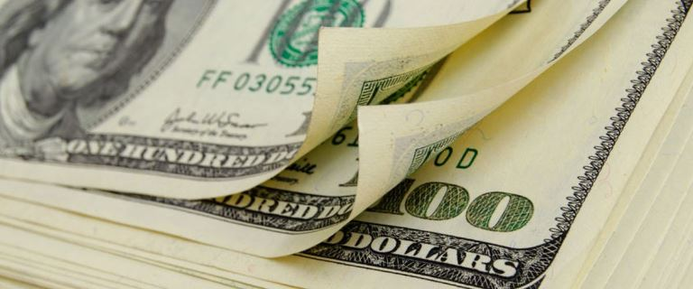46089472 - cash dollars lying on the plane.