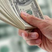 10349421 - hand of businessman holding dollars